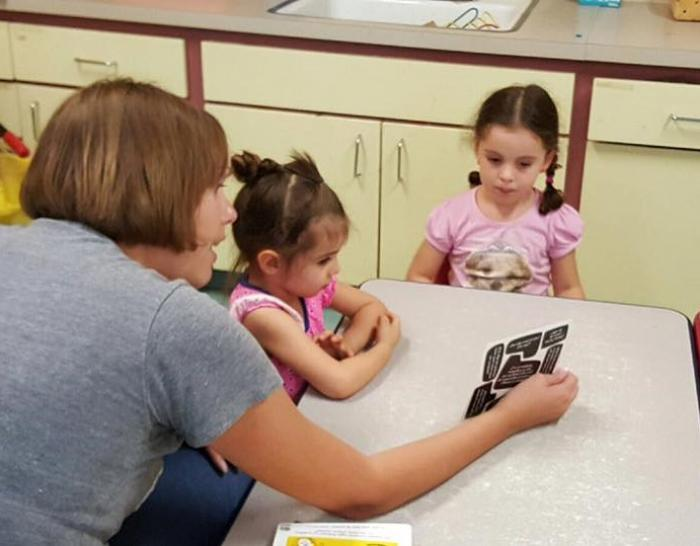 Amy Reed-Sandoval using the methods of philosophy to encourage children to think through big questions at Rayito del Sol Daycare and Learning Center in El Paso. Photo by Iván Sandoval-Cervantes.