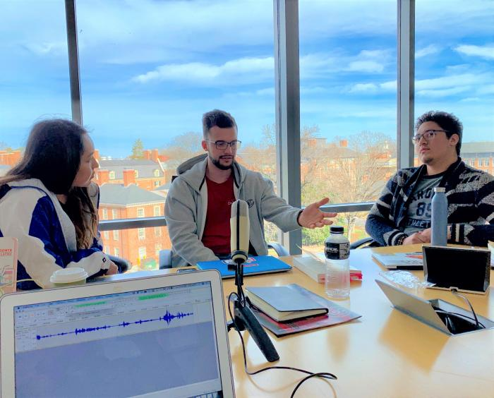 "Daisy Almonte, Axel Herrera, and Bryan Mejía, North Carolina-raised Latinx students, record the ""Nuestro South"" podcast in a room at U.N.C.-Chapel Hill."