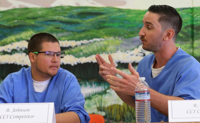 Incarcerated students participating in the Humanities Beyond Bars ethics bowl debate program at Tehachapi Prison, CA. Photo by Alex Horvath for The Bakersfield Californian.