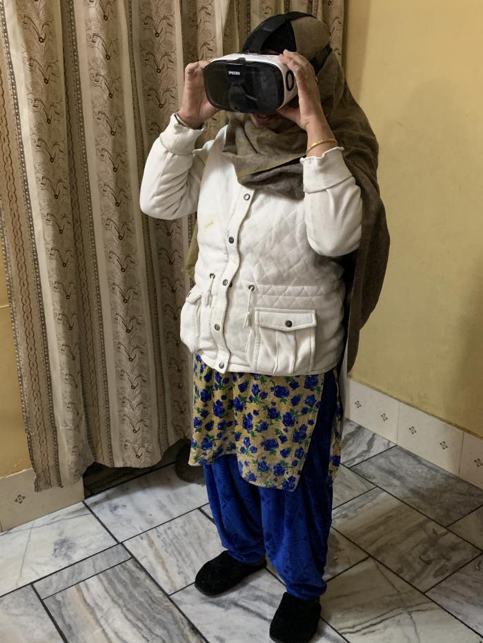 A woman watching a virtual reality film in India