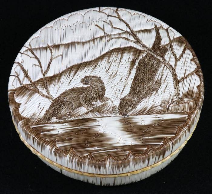 A quill box featuring otters made by Yvonne Walker Keshick using all natural quills. Image courtesy of MSU Museum collections, ID 2017:24.108. Photo by Pearl Yee Wong.