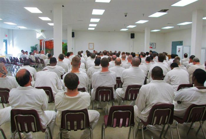 Inmates attend a staged reading at the Randall L. Williams Correction Center in Pine Bluff, AR