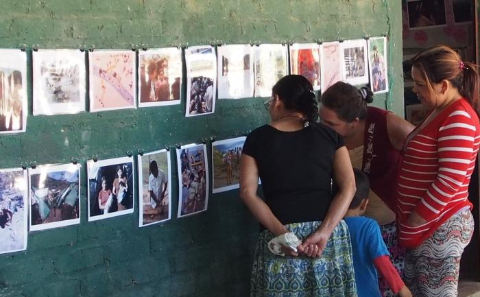 A younger generation learns about the refugee experience through photographs and family memories - photo by Molly Todd