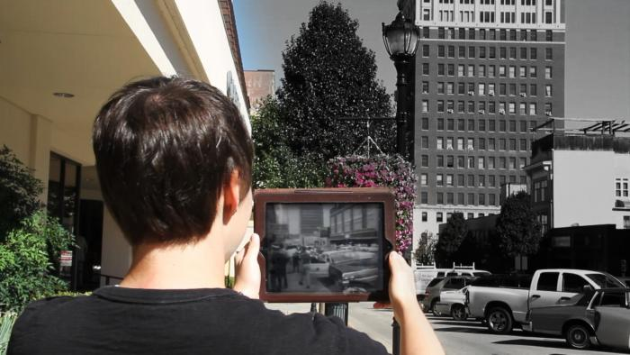 A student using Clio to watch newsreel footage of a 1963 sit-in on the site where it occurred